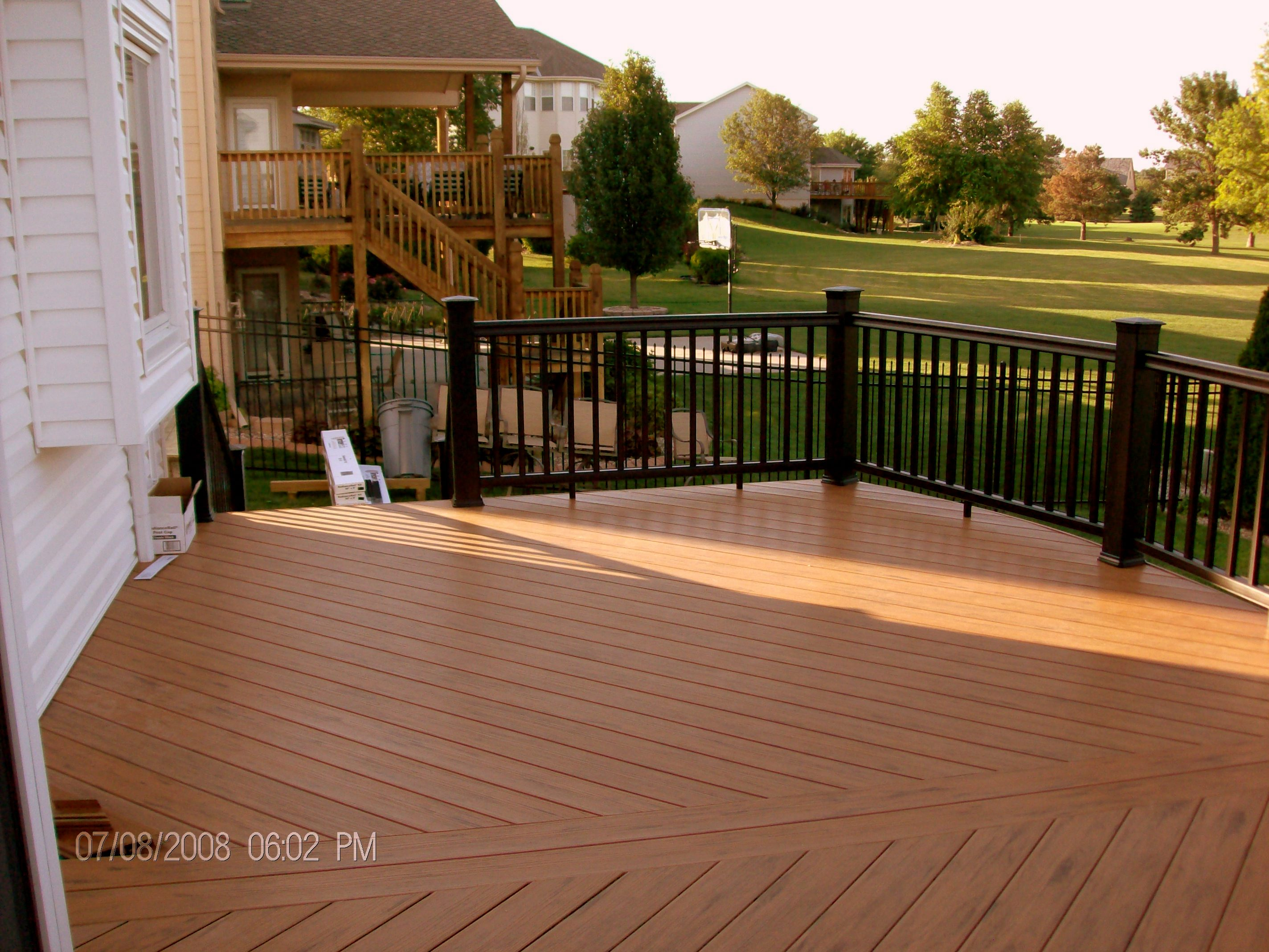 TimberTech Floorizon Deck in Tropical Teak with RadianceRail in Classic Black