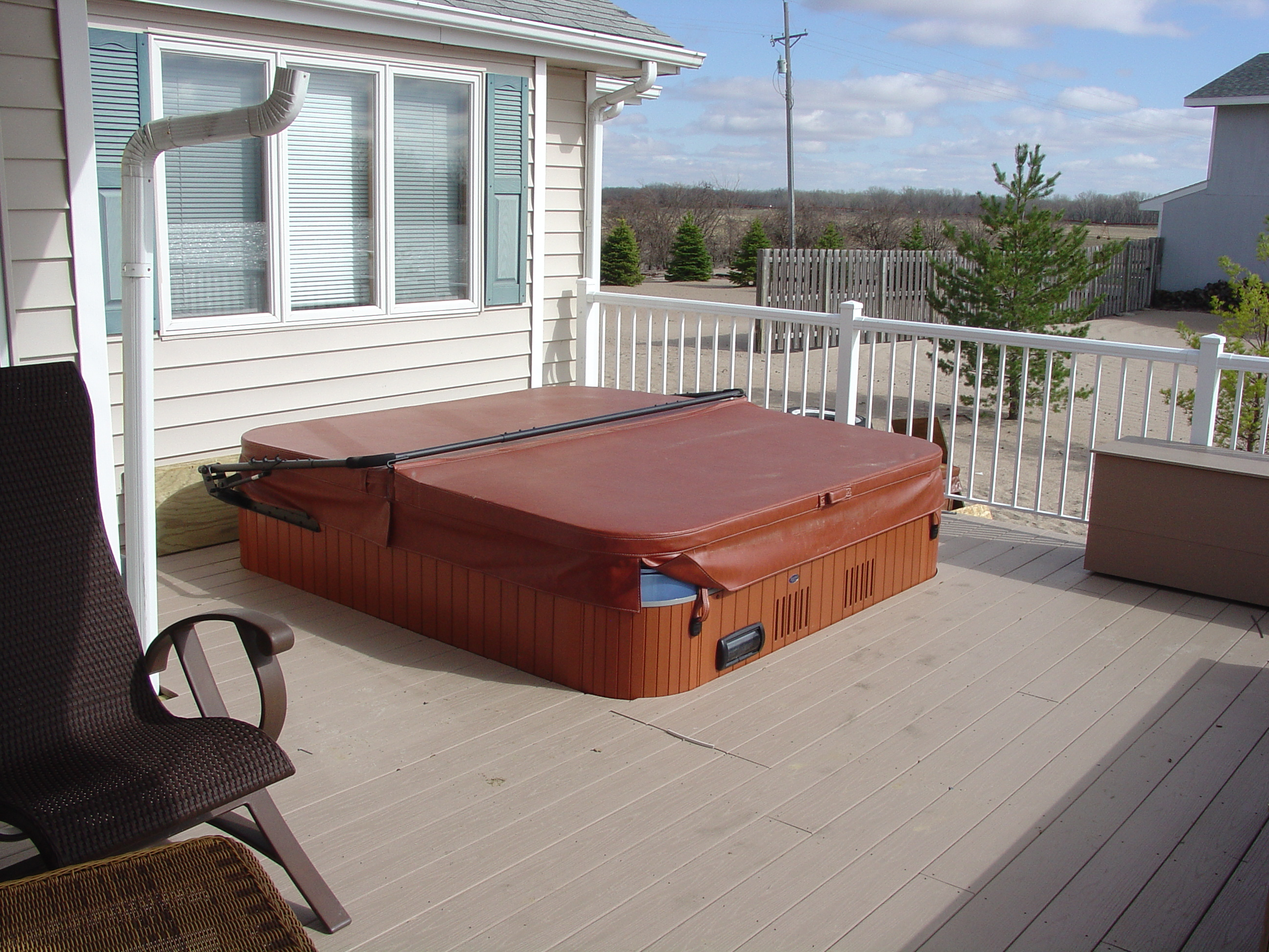 Mike jansen custom cedar decks deck building services for Free standing hot tub deck